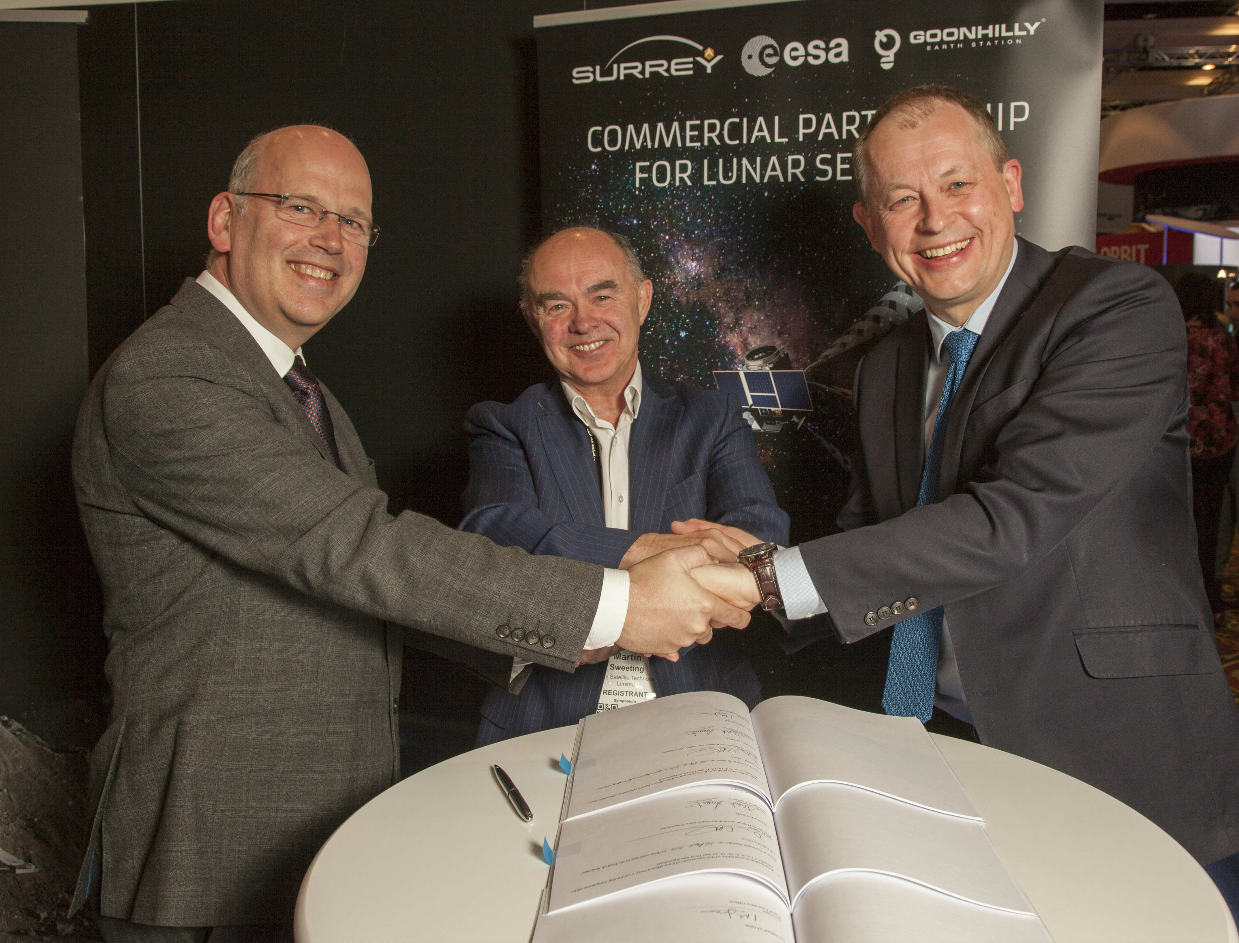 Men shaking hands after signing collaboration agreement with Goonhilly.